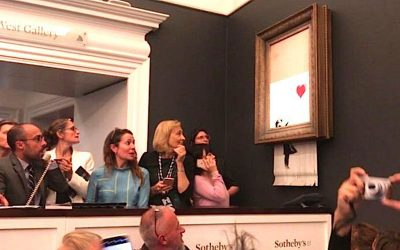 Banksy artwork worth £1 million shreds itself after an auction