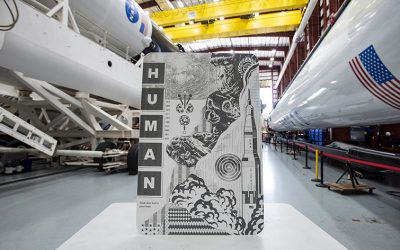 Elon Musk's SpaceX commissioned a street artist to create indestructible gold paintings as décor for its first trip to the International Space Station